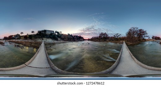 360 Equirectangular Panorama of the sunrise and moonset from a footbridge on the Guadalupe River in Kerrville, Texas.