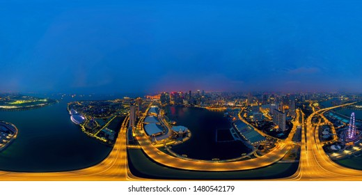 360 panorama by 180 degrees angle seamless panorama view of aerial view of Singapore Downtown. Financial district in technology smart urban city in Asia. Skyscraper buildings at night.
