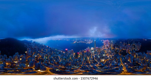 360 panorama by 180 degrees angle seamless panorama view of aerial view of Hong Kong Downtown. Financial district and business centers in technology smart city. skyscraper and buildings at night.