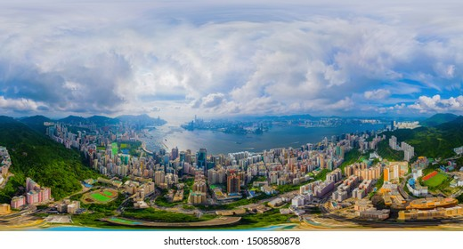 360 panorama by 180 degrees angle seamless panorama view of aerial view of Hong Kong Downtown. Financial district and business centers in technology smart city. skyscraper and buildings at noon.