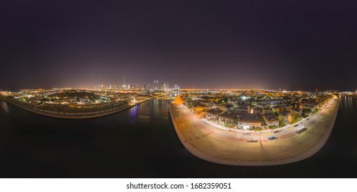 360 panorama by 180 degrees angle seamless panorama of aerial view of Dubai Downtown skyline and highway, United Arab Emirates or UAE. Financial district in urban city. Skyscraper buildings at night.