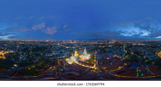 360 panorama by 180 degrees angle seamless panorama of aerial view of the Giant Golden Buddha in Wat Paknam Phasi Charoen Temple in Phasi Charoen district at night, Bangkok. Urban town, Thailand.