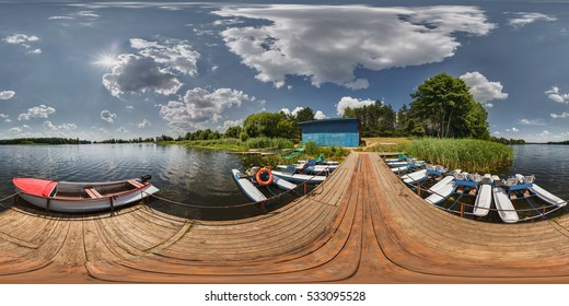 360 panorama on boat station on lake in sunny day. Full 360 by 180 degrees angle seamless panorama view. Skybox as background in equirectangular spherical equidistant projection for VR AR content