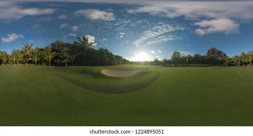 360 Vdegree panorama of beautiful green landscape with golf course, palms and Le Morne Brabant mountain. Vast green lawns in bright sunlight