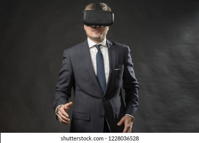360. Virtual game. Man in black suit uses a virtual reality glasses.  VR