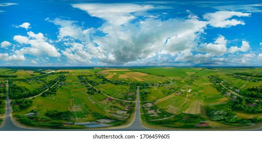 360-degree pano of Aerial view of a beautiful landscape with white clouds in the colorful sky. Aerial view of the countryside with village and fields of crops in summer.