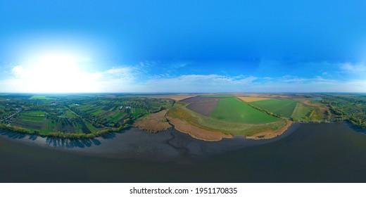 360-degree pano of Aerial view over the middle of a large river. Summer colorful landscape. 360-degree aerial view from a drone of a large river and small town