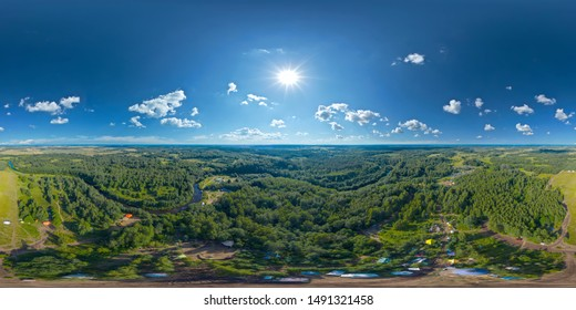 360-degree panoramic aerial view of a field and a meandering river in a green country