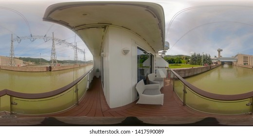 360VR cruising on riverboat through the Iron Gate 2 hydroelectric power plant locks on the Danube River between Serbia and Romania countryside.