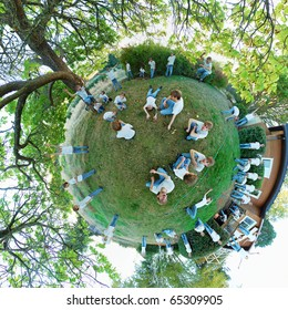 A 360x180 stereographic polar panorama with a young teenage man laying down on the grass in several different positions, with a tree inside of a circle.