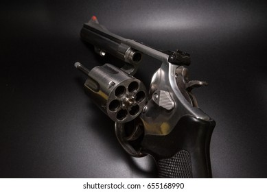 .38  Revolver open ready to put bullets  in black background