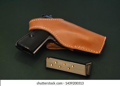 .380 gun auto pistol in leather holster