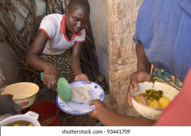 LUSAKA,ZAMBIA–DECEMBER 3:A cook distributed the food to workers in the potato field, offer them food every day to 300 workers, on December 3,2011 in Lusaka,Zambia