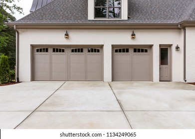3-car garages with a long concrete driveway
