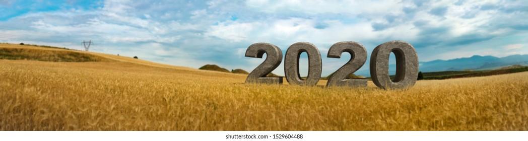 3D 2020 text inside field of wheat, next to historical tumulus graves panorama view. Bintepeler, Salihli Manisa
