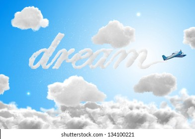 3D Airplane writing the word dream in the sky - travel concepts