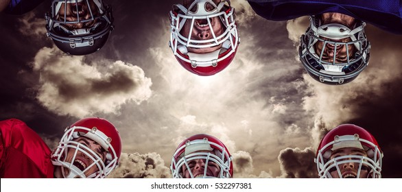 3D American football huddle against dark sky with white clouds