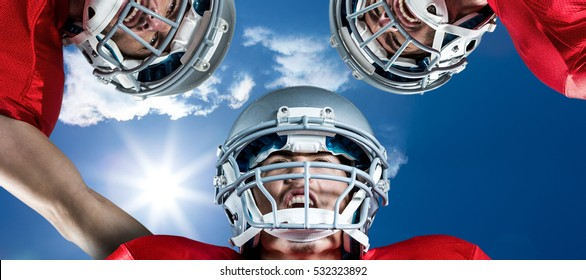 3D American football huddle against bright blue sky with clouds