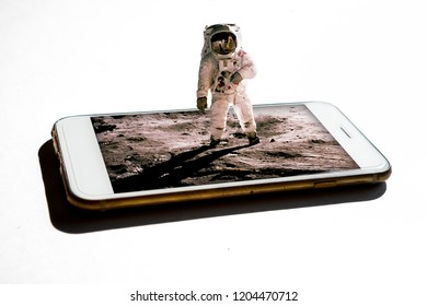 3D astronaut coming out from the smartphone with isolated on white background - 3d future technology digital world concept - getting the news in 3D from phone Elements of this image furnished by NASA