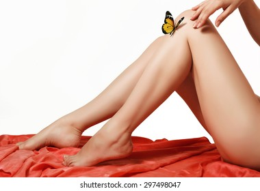 3d beautiful butterfly on a silky and delicate female legs