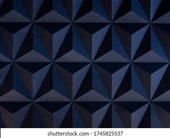 3D dark blue wall panel seamless texture with geometric triangle pattern