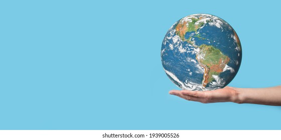 3D Earth planet globe in man, woman hand, hands on blue background. Environmental protection concept. Elements of this image furnished by NASA.
