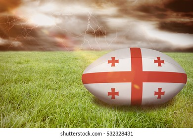 3D georgia rugby ball against stormy dark sky with lightning bolts