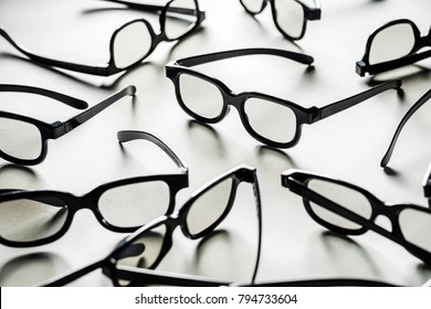A lot of 3d glasses on a white background. Eyeglasses frames texture.