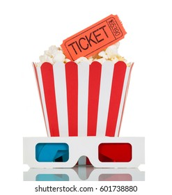 3D glasses, a striped box, filled with popcorn and movie tickets isolated on white background.