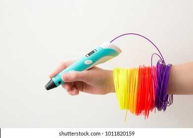 3d handle (pen). Colored plastic in coils. 3d paintings and figures with their own hands. Handmade. STEM education. Play and study at school and at home. New toy for child. Background. Like.