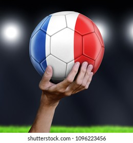 3d illustration.  Man holding Soccer ball with French flag