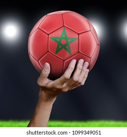 3d illustration. Man holding Soccer ball with Moroccan flag
