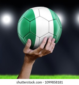3d illustration. Man holding Soccer ball with Nigerian flag