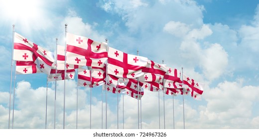 3D Illustration of many flags of Georgia in rows waving in the wind against blue sky