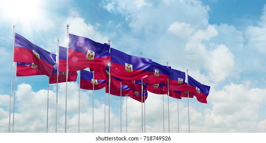 3d Illustration of many flags of Haiti in rows waving in the wind against blue sky