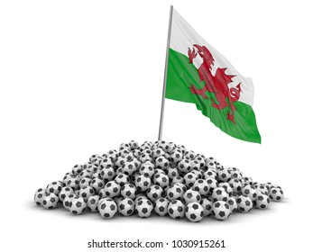 3d illustration. Pile of Soccer footballs and Flag of Wales. Image with clipping path