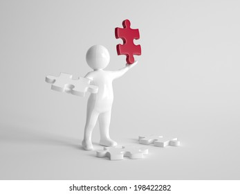 3d man finds the solution to a problem standing surrounded by white puzzle pieces with one in his hand while holding aloft a single red piece in his other hand, on grey