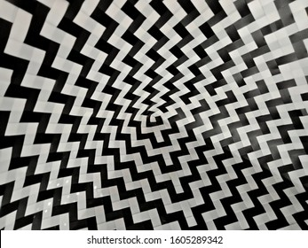 3D pattern from a black and white plastic sheet weave into alternating patterns