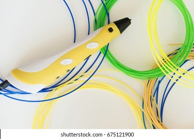 3D pen and colorful filament on white background