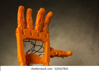 3D Printed Orange Prosthetic Hand