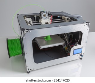 3d printer with bright green filament.