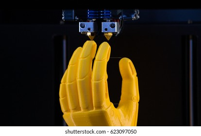 3d printer prints the model of the hand, the process of printing the hand prosthesis on the 3d printer.