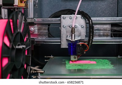 3d printer prints the model of the hand, like, the process of printing the hand on the 3d printer.