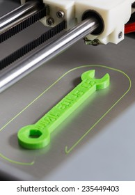 3d printing with light green filament.