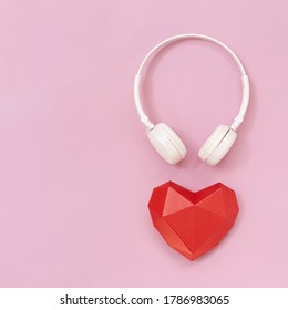 3d red paper heart and white headphones. Concept for music festivals, radio stations, music lovers.  Live with music. Minimal style.