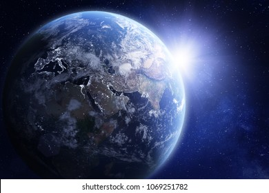 3D render of planet Earth viewed from space, with night lights in Europe and sun rising over Asia. Blue hue treatment. Elements from NASA