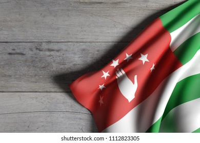 3d rendering of Abkhazia flag over a wooden surface