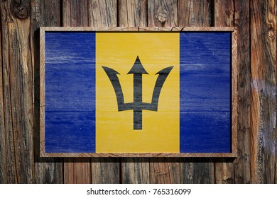 3d rendering of Barbados flag on a wooden frame over a planks wall