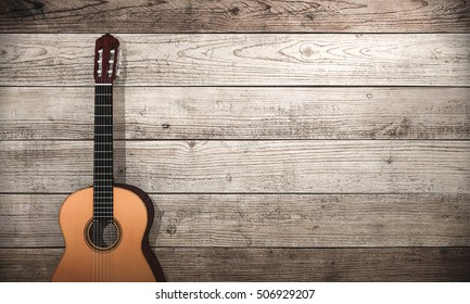 3d rendering classical guitar near wooden wall