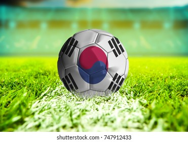 3D rendering football ball with the national flag of Korea South ball with Green grass background